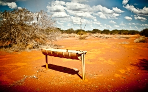 Old Water Trough on red sand Photo Drew Barrett