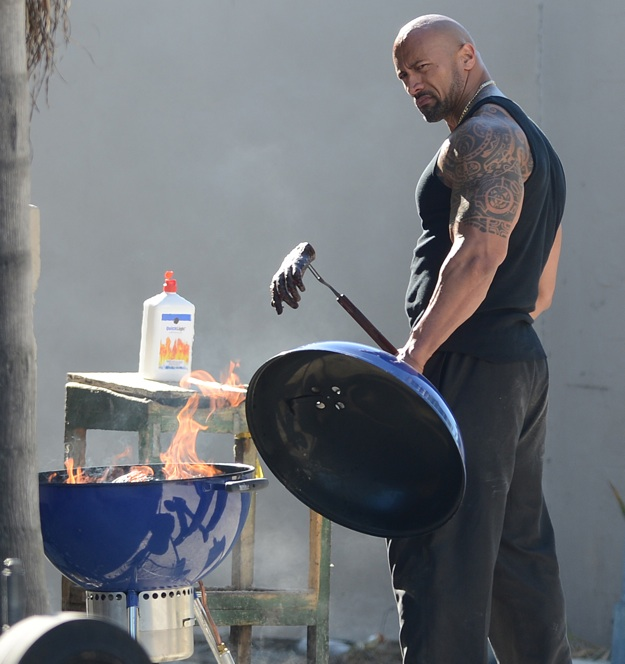 Dwayne 'The Rock' Johnson BBQ's a severed hand on the 'Pain and Gain' filmset, FL