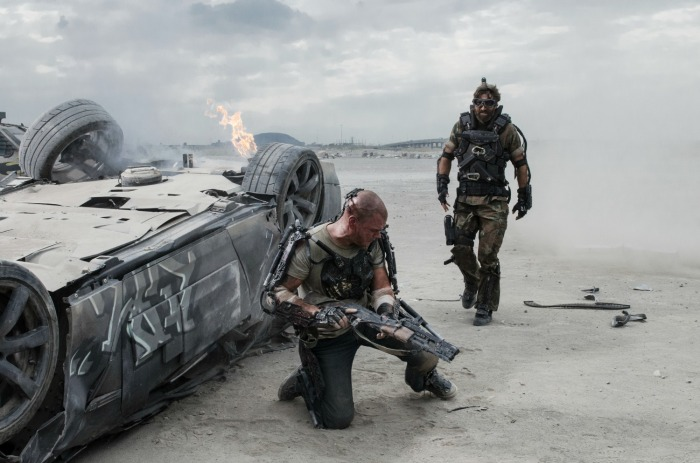 Matt Damon (left) and Sharlto Copley in Columbia Pictures' ELYSIUM.