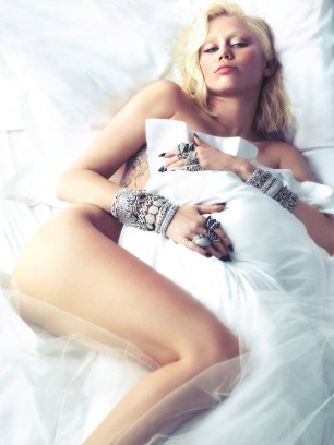 Miley Cyrus Naked on a bed with pillow