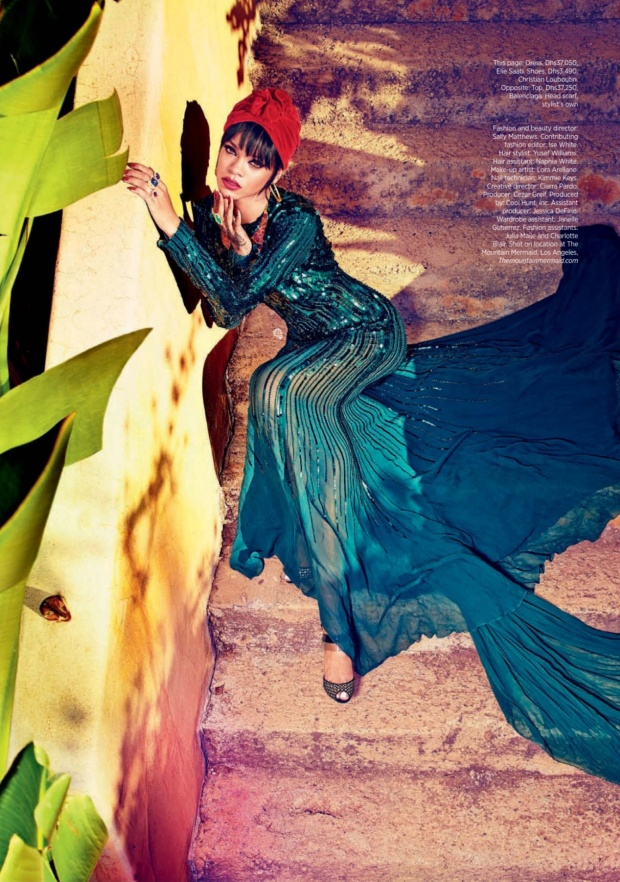 Rihanna Stuns in Harper's Bazaar Arabia, sitting on footpath